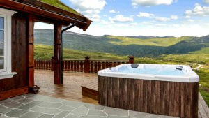 Hot tub on patio, overlooking green rolling hills